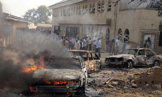 File photo shows a car burning at the scene of a Boko Haram bomb explosion at St. Theresa Catholic Church in Madalla, Nigeria