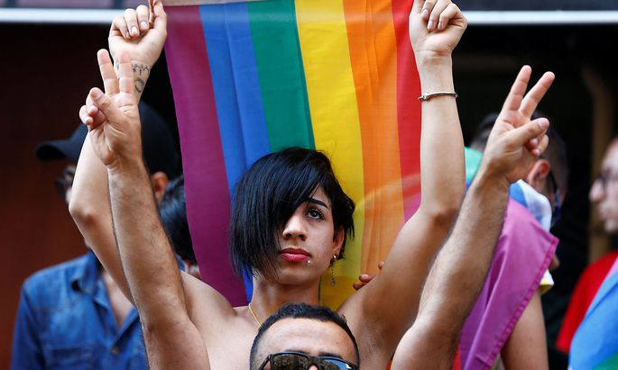 Members of LGBT community take part in a Gay Pride parade in central Istanbul