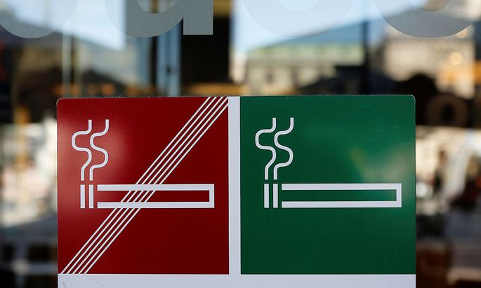 A smoking and non smoking sign are seen on the door of a coffee bar in Vienna
