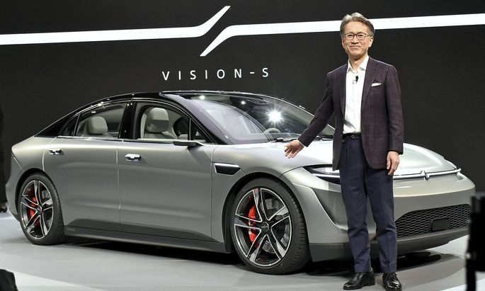 Sony s prototype EV Sony Corp. President and CEO Kenichiro Yoshida stands next to the company s first prototype of an el