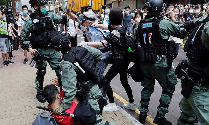 Bilder vom Anti-Regierungsprotest in Hongkong. Die Situation in den USA ermöglicht es China, Kritik daran abzuschmettern.