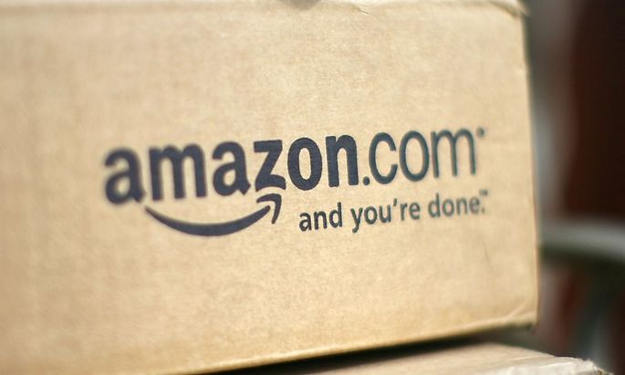 File of a box from Amazon.com is pictured on the porch of a house in Golden