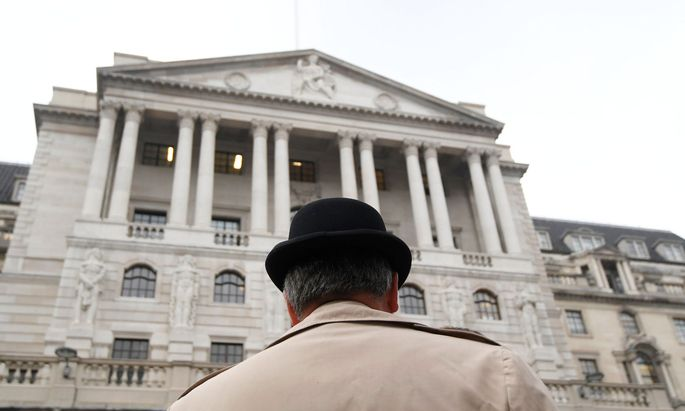 A man wears a bowler hat outside the Bank of England in the City of London