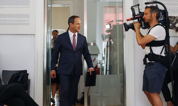 Head of NEOS party Strolz arrives for a news conference in Vienna