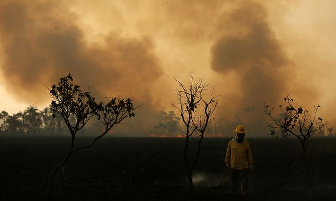 IBAMA fire brigade member is seen as he attempts to control hot points during a fire at Tenharim Marmelos Indigenous Land