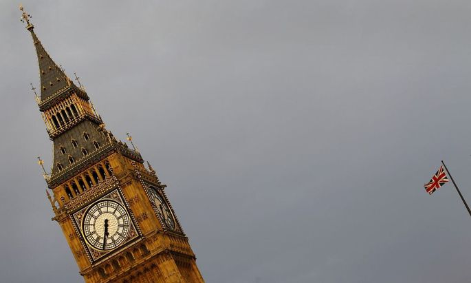 An Union flag is seen fluttering next to the Big Ben in London