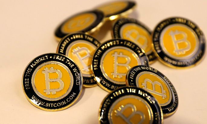 Bitcoin.com buttons are seen displayed on the floor of the Consensus 2018 blockchain technology conference in New York City