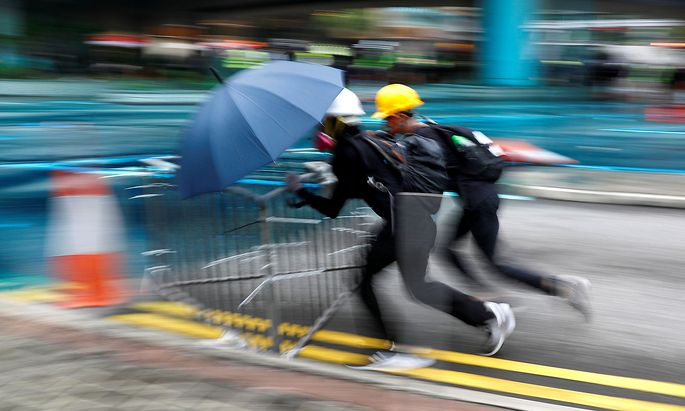 Demonstrators push the barriers during a protest in Hong Kong