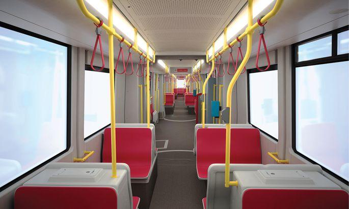 Das gar nicht so neue Innenleben der neuen Flexity-Garnituren: rote Sitze, gelbe Haltestangen, graue Böden und Wände.