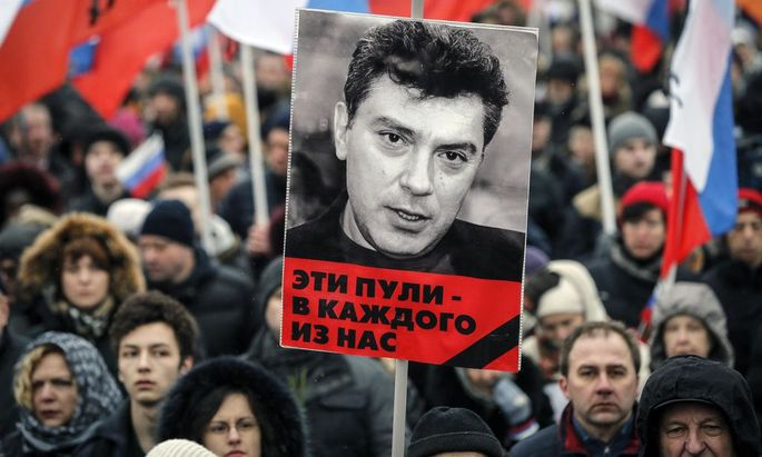 A portrait of Kremlin critic Boris Nemtsov, who was shot dead on Friday night, is seen during a march to commemorate him in central Moscow
