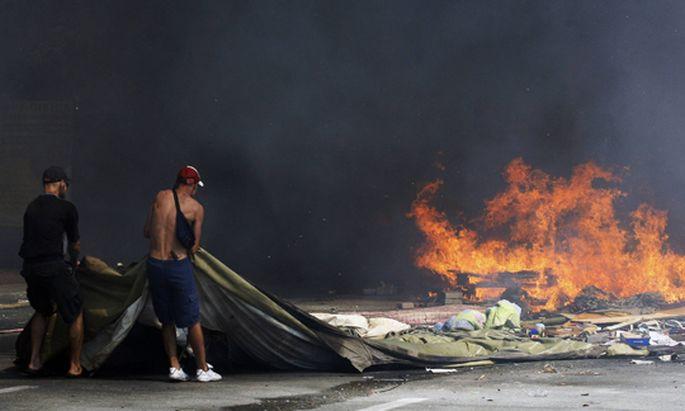 ITAR TASS KIEV UKRAINE AUGUST 7 2014 Maidan activists have set tyres on fire as they protest ag