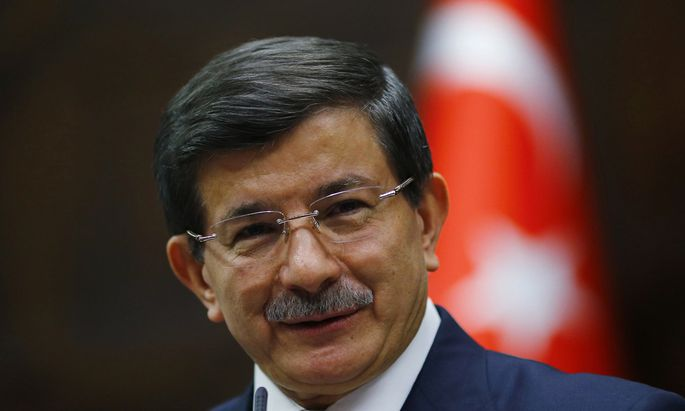 Turkey´s Prime Minister Ahmet Davutoglu addresses members of parliament from his ruling AK Party (AKP) during a meeting at the Turkish parliament in Ankara