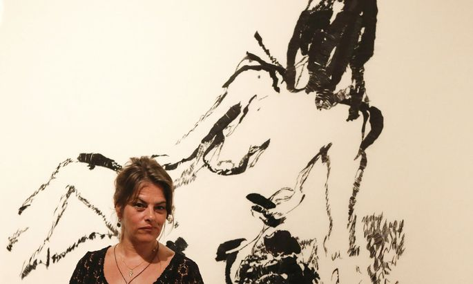 British artist Tracey Emin poses in front of her painting ´Distant Memory´ in Leopold Museum in Vienna