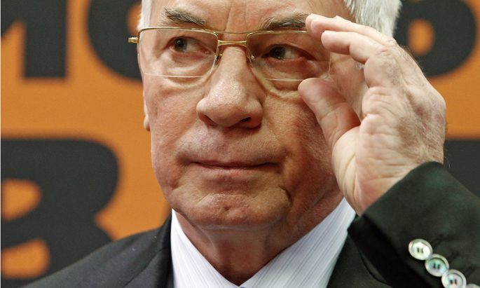 Ukraine´s former PM Azarov attends a news conference in Moscow