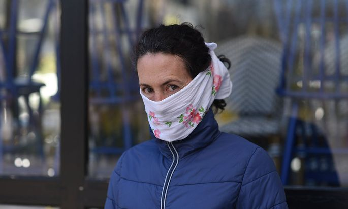 Daily life in Paris during coronavirus lockdown April 05, 2020 - Paris, France: Portrait of a woman with a protection ho