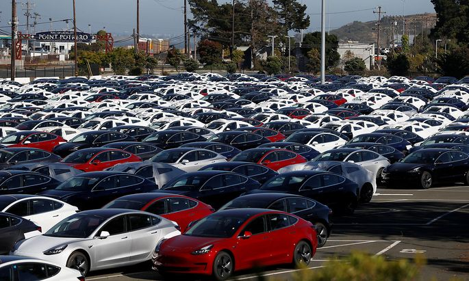 A parking lot of predominantly new Tesla Model 3 electric vehicles is seen in Richmond, California