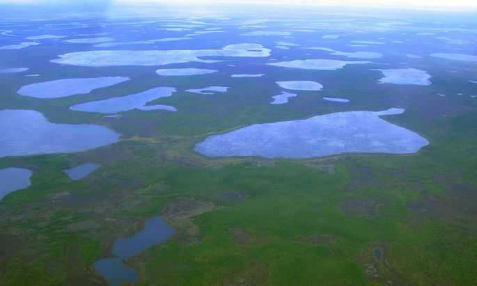 FILE PHOTO: An aerial view shows thermokarst lakes outside the town of Chersky in northeast Siberia