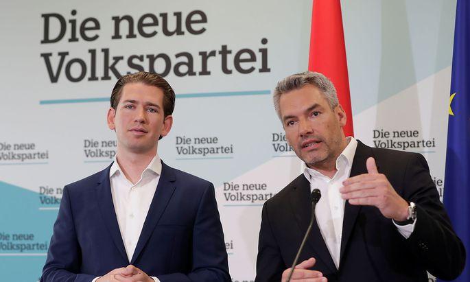 Former Austrian Chancellor Kurz and OeVP Secretary General Nehammer address the media in Vienna