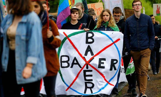 FILE PHOTO: Protests ahead of German drug and crop chemical maker Bayer's annual general meeting
