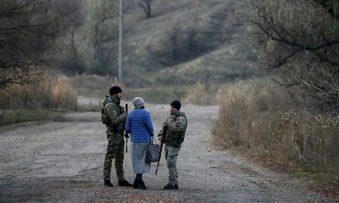 Servicemen patrol in the village of Katerynivka