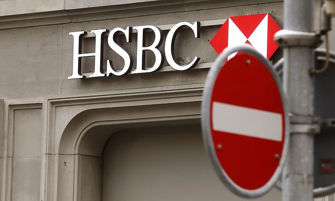 A traffic sign is seen in front of a branch office of HSBC bank at the Paradeplatz in Zurich