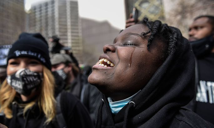 April 20, 2021, Minneapolis, Minnesota, USA: People react to the guilty verdict of the Derek Chauvin trial at the Henne
