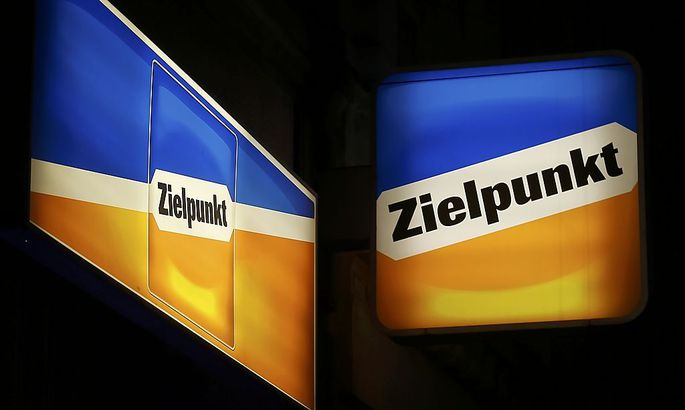 Logos of Austrian supermarket chain Zielpunkt are illuminated outside one of its stores in Vienna