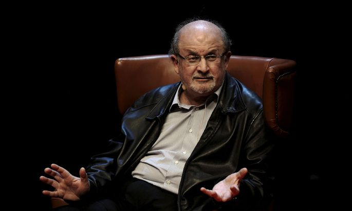 Author Rushdie gestures during a news conference before the presentation of his latest book ´Two Years Eight Months and Twenty-Eight Nights´ at the Niemeyer Center in Aviles