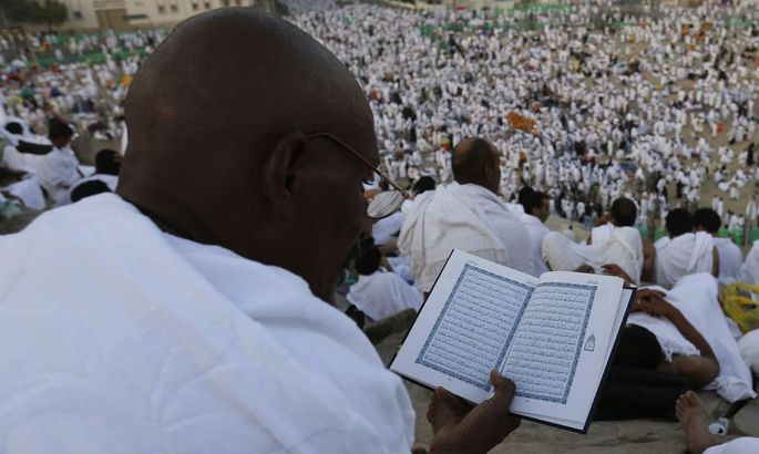 Muslim pilgrim reads the Koran on Mount Mercy on the plains of Arafat during the annual haj pilgrimage, outside the holy city of Mecca