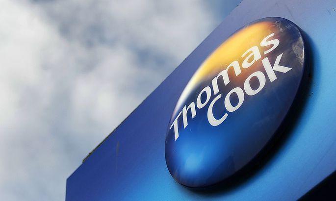 BRITAIN THOMAS COOK PROFITS HIT SWINE FLU
