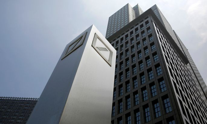 FILE PHOTO: Logos of Deutsche Bank AG are seen in Tokyo