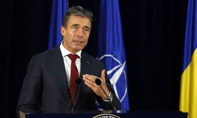 NATO Secretary-General Anders Fogh Rasmussen gestures during a joint news conference at Cotroceni Presidential Palace in Bucharest
