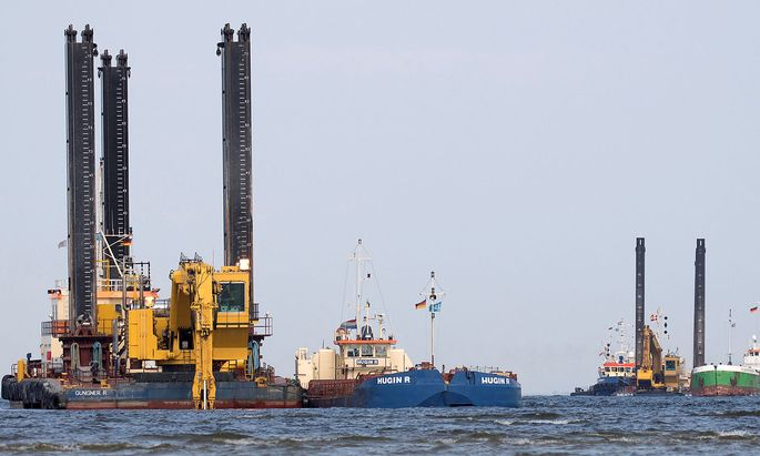FILE PHOTO: Floating excavators prepare an underwater trench for the North Stream 2 pipeline close to Lubmin