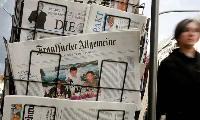FILE PHOTO: A Frankfurter Allgemeine Zeitung and other papers are displayed for sale in front of a newspaper shop in Berli