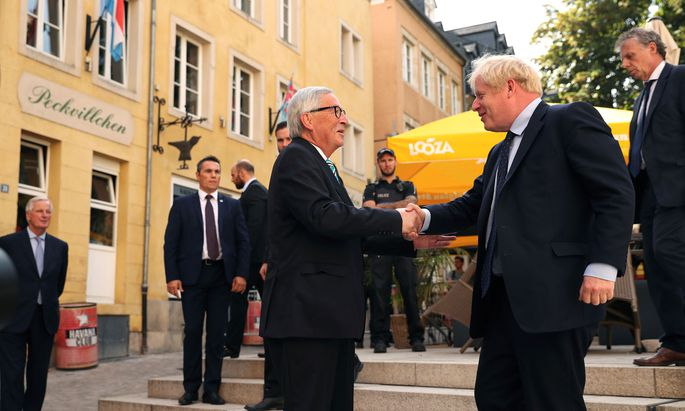 EC President Juncker shakes hands with British PM Johnson in Luxembourg