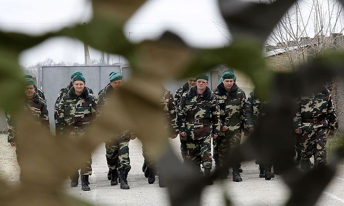 Ukrainian servicemen, recently mobilized to join border troops, walk in formation at tent camp located near border of Ukraine with Moldova's self-proclaimed separatist Transdniestria region, in Odessa region
