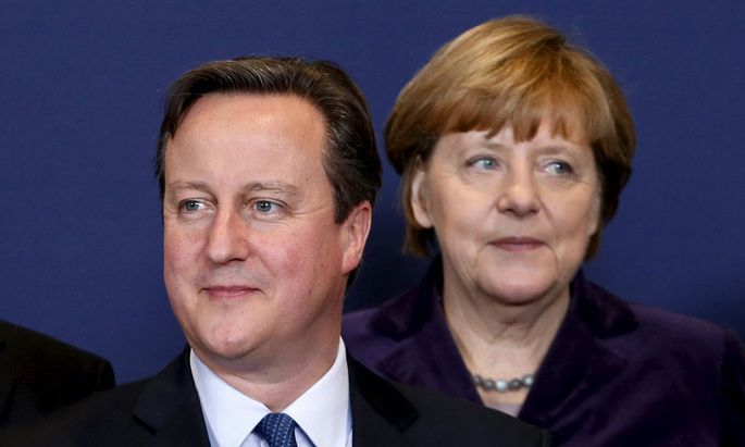 Britain´s PM Cameron and Germany´s Chancellor Merkel pose for a family photo during a EU leaders summit in Brussels