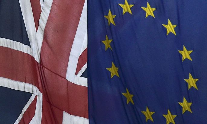 File photograph of European Union and the British Union flags flying outside Europe House in London