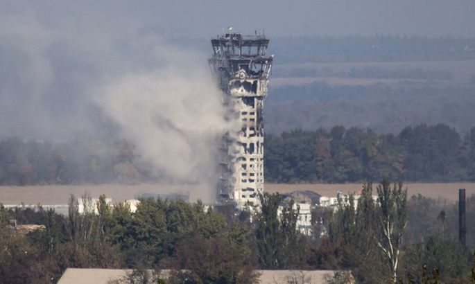 A Ukrainian national flag flies in the traffic control tower of the Donetsk Sergey Prokofiev International Airport hit by shelling during fighting between pro-Russian rebels and Ukrainian government forces in Donetsk