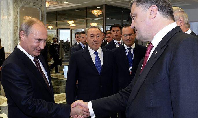 Wladimir Putin und Petro Poroschenko - hier bei ihrem letzten Treffen in Minsk - sollen sich in manchen Dingen einig sein, berichtet man in Moskau.