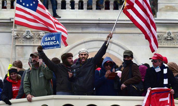 Amerika sei nach dem Sturm rechtsextremer Trump-Anhänger auf Capitol Hill in Washington in seinem Glauben an die Demokratie erschüttert, heißt es nach den hässlichen Bildern vom Mittwoch.