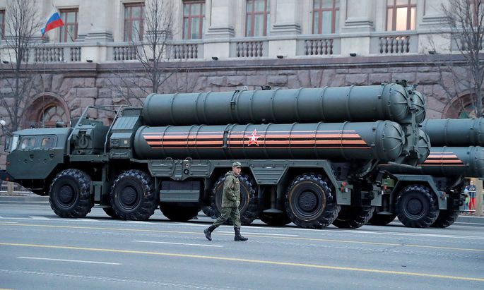 FILE PHOTO: A Russian serviceman walks past air defence systems before a rehearsal for the Victory Day parade in central Moscow