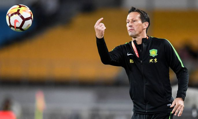Head coach Roger Schmidt of Beijing Sinobo Guoan reacts as he watches his players competing against