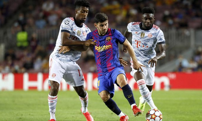 Barcelona, Spain, September 14th 2021: Kingsley Coman (11 Bayern Munchen) and Yusuf Demir (11 FC Barcelona, Barca during