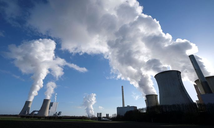 FILE PHOTO: The lignite power plants of 'Neurath New', Niederaussem, and 'Neurath Old' of German energy supplier and utility RWE are pictured in Neurath