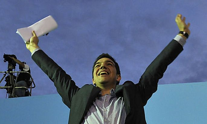 Greek leader of Coalition of the Radical Left party (SYRIZA) Alexis Tsipras waves to the crowd after
