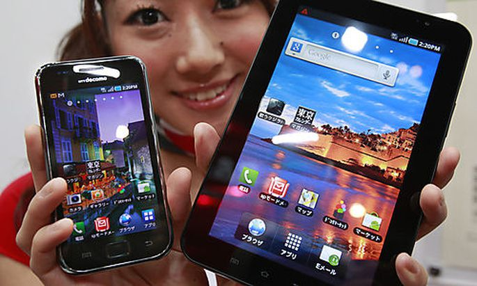A model shows NT DoCoMps smart phones, Galaxy S, left, and Galaxy Tab, made by South Korean electrons smart phones, Galaxy S, left, and Galaxy Tab, made by South Korean electron