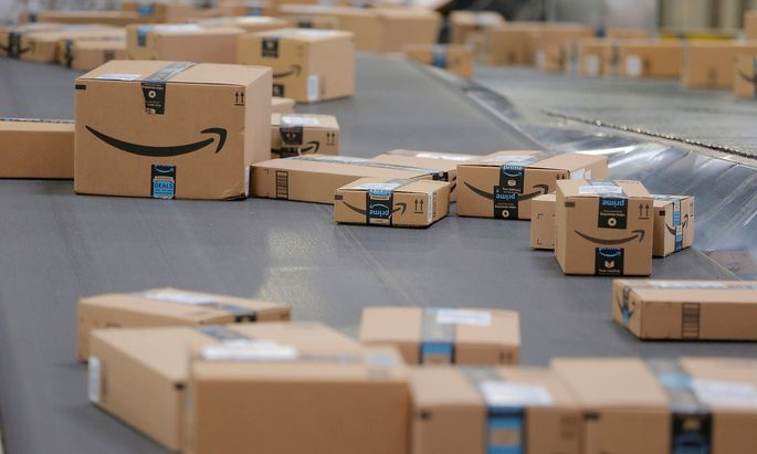 Packages travel along a conveyor belt inside of an Amazon fulfillment center in Robbinsville, New Jersey