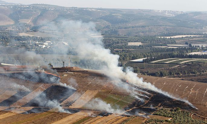 Smoke rises from shells fired from Israel in Maroun Al-Ras village, near the border with Israel, in southern Lebanon