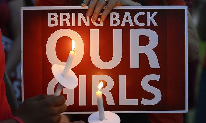People participate in a ´Bring Back Our Girls´ campaign on Mother´s Day in Los Angeles